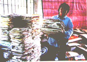 Stack up those newspaper high and steady, donate them to us you'll be helping the needy