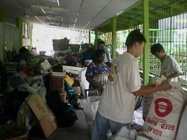 XPM member sorting out the recyclable material